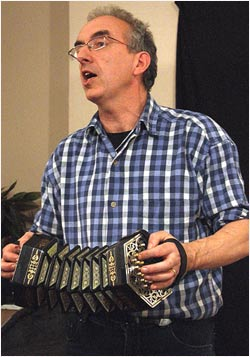 Photo of Brian Peters playing concertina